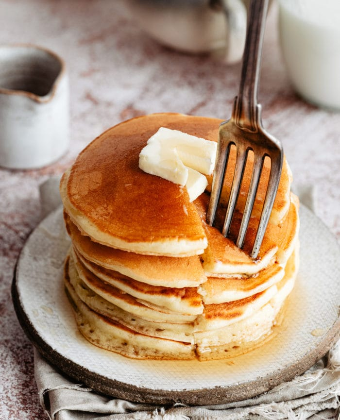 photo of a stack of pancakes with a fork