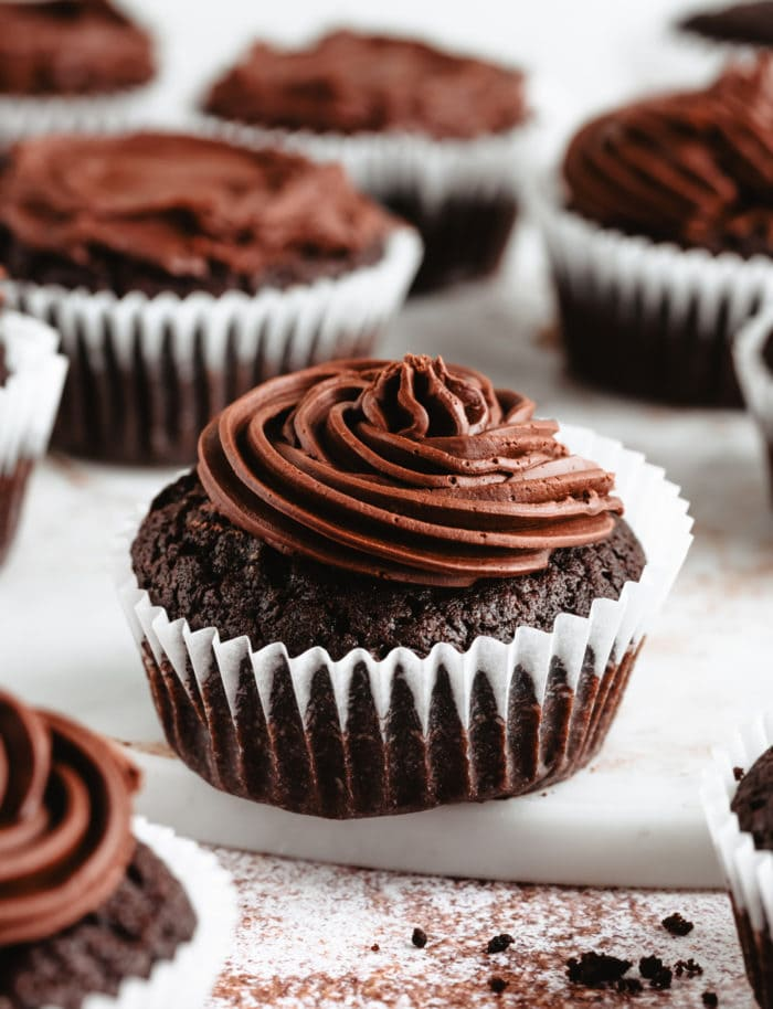 photo of a cupcake frosted with ganache