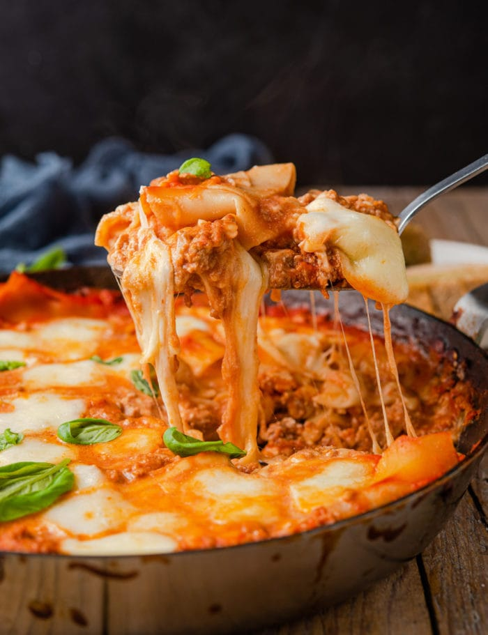 photo of skillet lasagna being scooped out of the pan