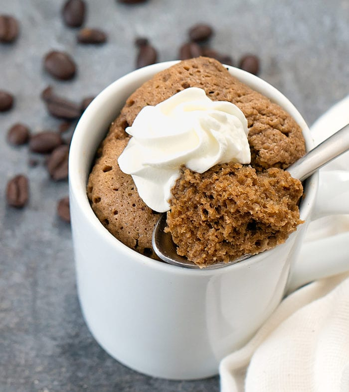 overhead photo of a coffee flavored mug cake with a spoon