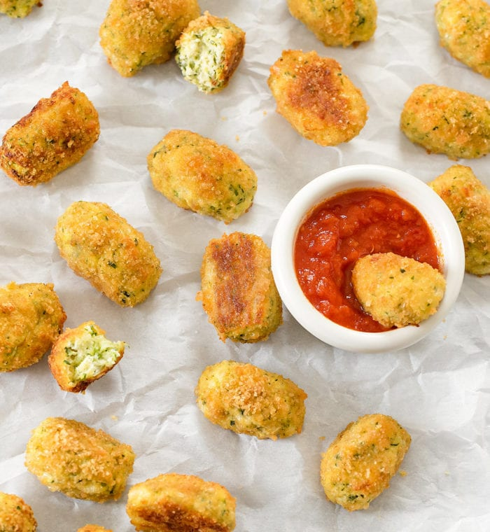 overhead photo of zucchini tots on parchment