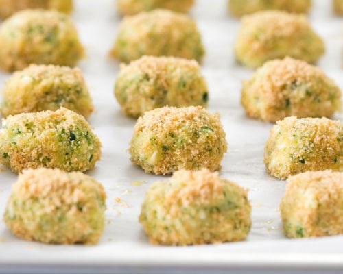 close-up photo of tots ready to go in the oven