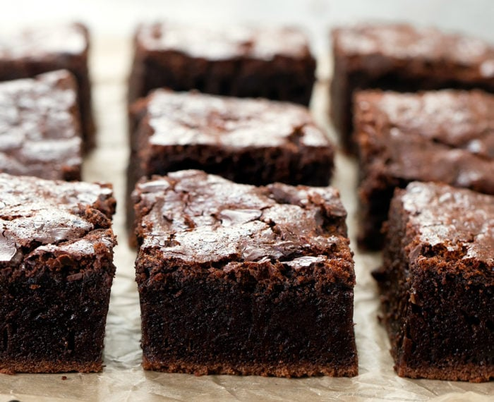 photo of brownies lined up on parchment