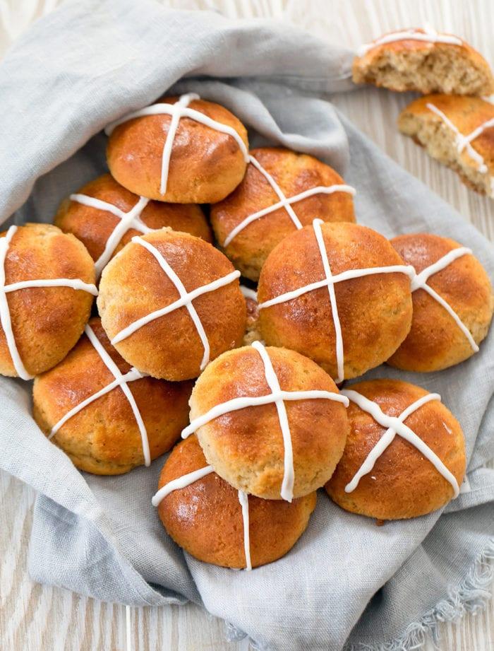 overhead photo of a basket of hot cross buns