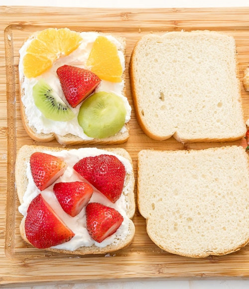 overhead photo of fruit sandwiches being assembled