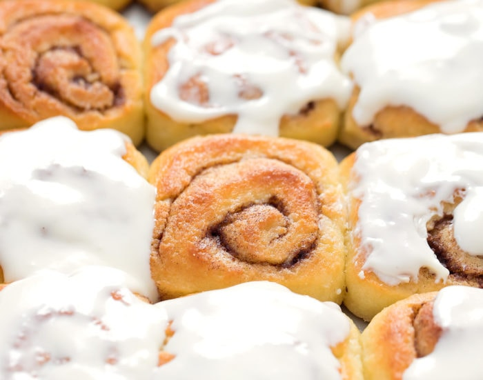 close up photo of cinnamon rolls with icing