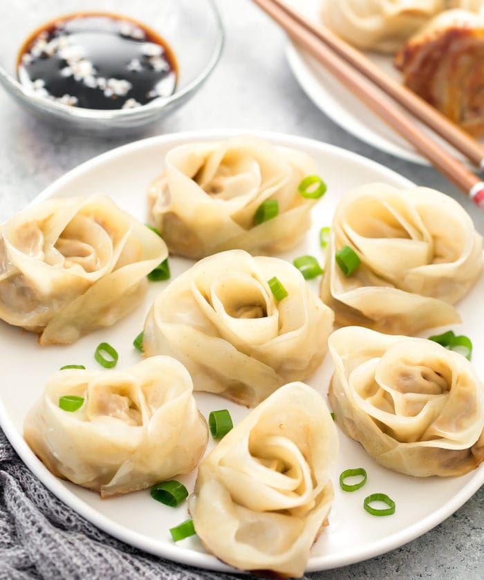photo of rose dumplings on a plate with a bowl of sauce