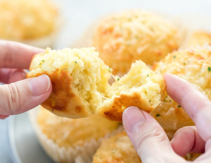 close-up photo of a muffin being torn in half