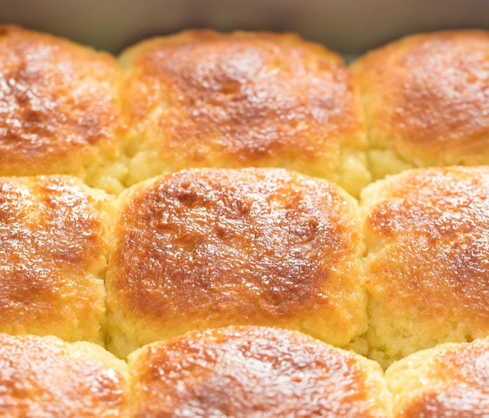 close-up photo of rolls in a baking pan