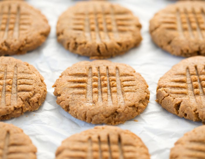 photo of peanut butter cookies on parchment paper