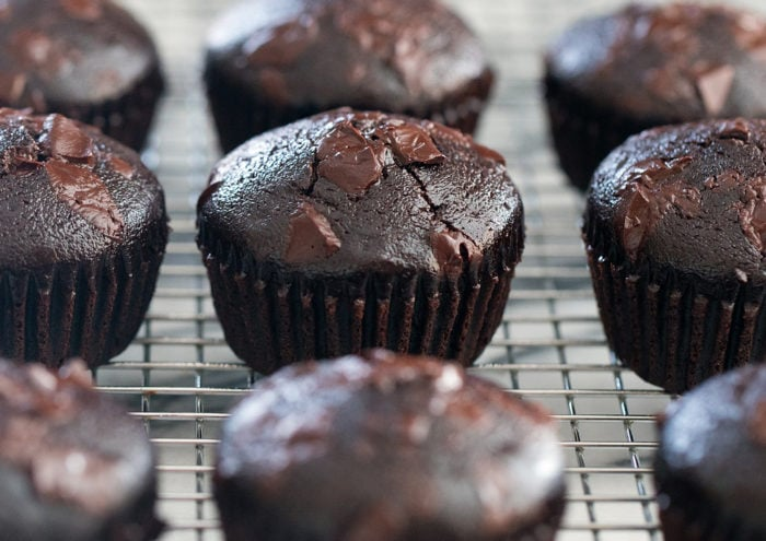 close-up photo of muffins lined up on a baking rack