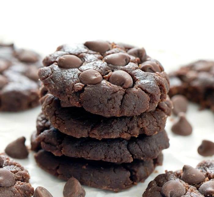 a stack of four chocolate peanut butter cookies
