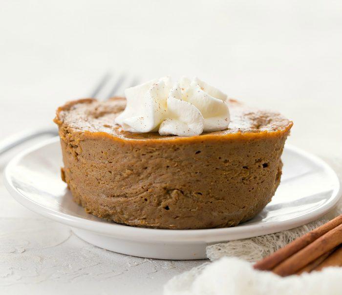 a pumpkin pie on a plate