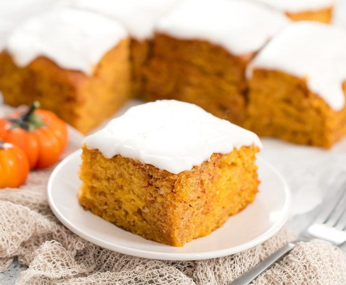 a slice of pumpkin cake on small white plate.
