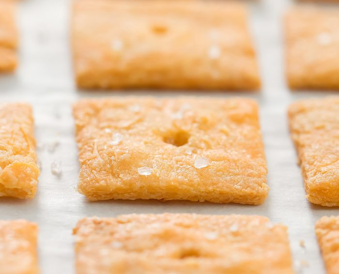 close up of baked crackers on a baking sheet