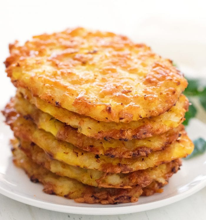 six low carb hash browns on a white plate