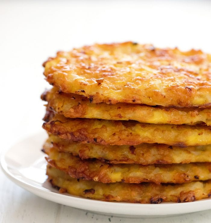 stack of cauliflower hash browns on a plate