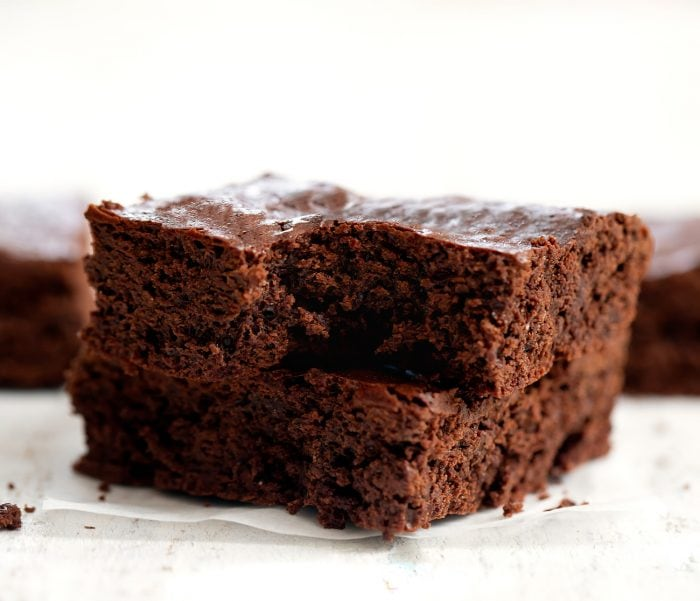 a stack of flourless brownies.