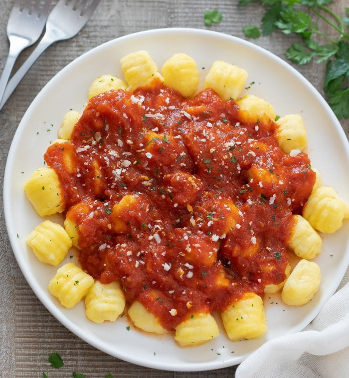 overhead shot of a plate of gnocchi with marinara.