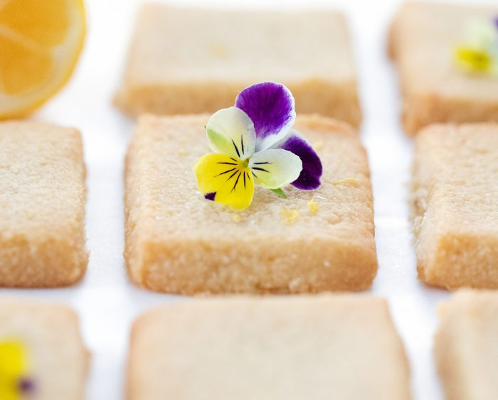 a shortbread cookie with a flower on top.
