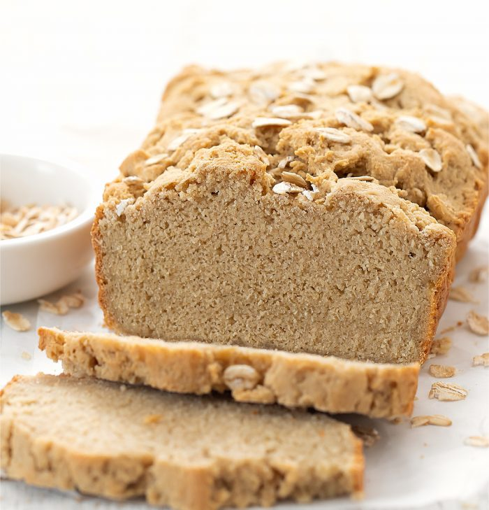 a sliced loaf of oat bread.