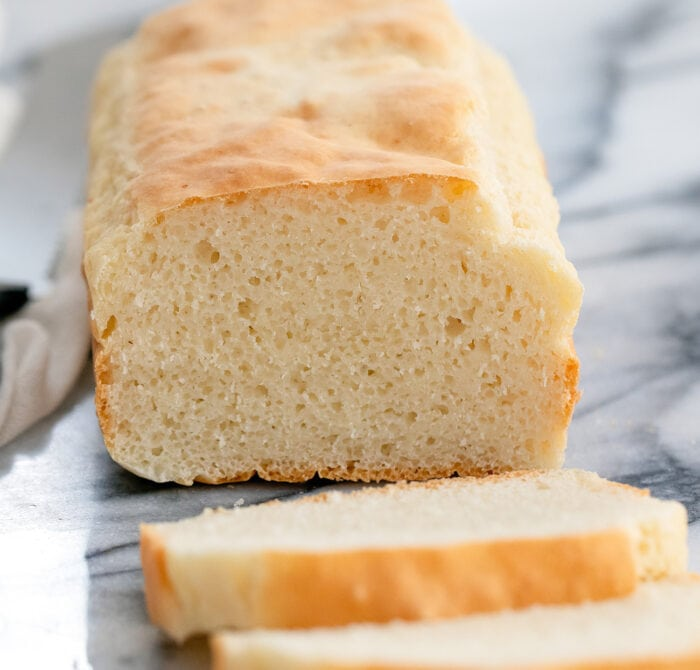 a loaf of bread with slices cut off.