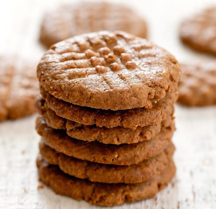 close up photo of a stack of almond butter cookies.