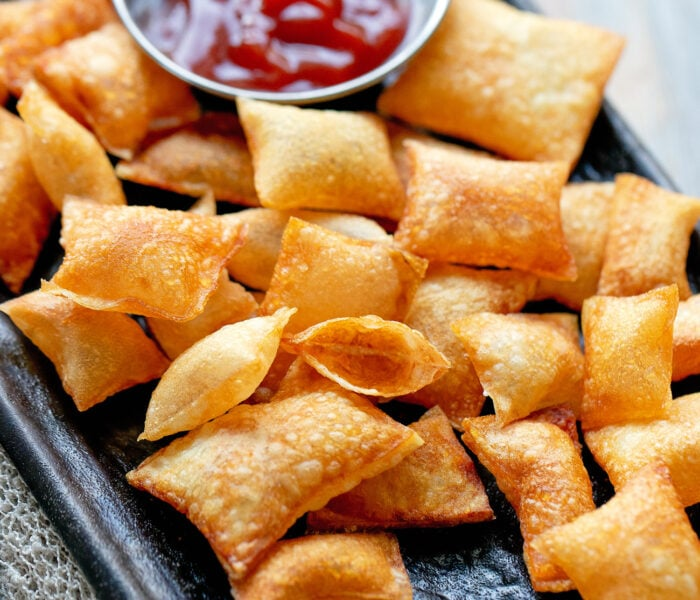 bubble chips on a platter with a small bowl of ketchup.