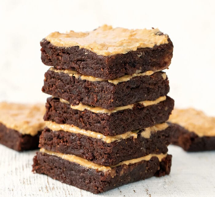 a stack of five frosted brownies.