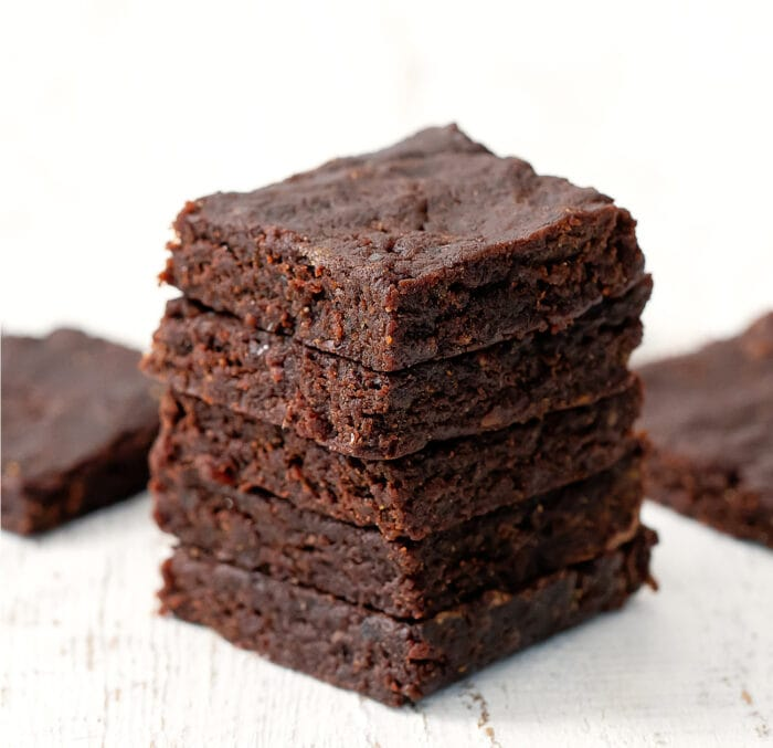 a stack of unfrosted brownies.